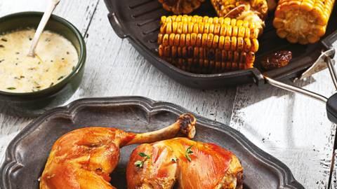Печено пилешко бутче със сметанов сос и грилована царевица